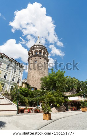 Galata Tower in the background of blue sky with clouds. - stock photo