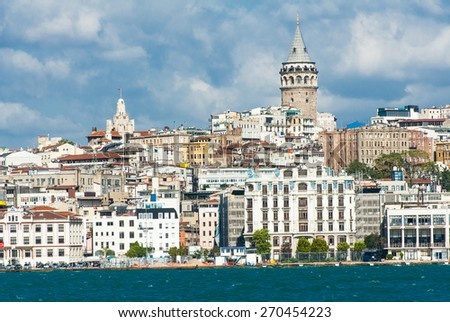Galata Tower over the Golden Horn in Istanbul, Turkey seen from the ship - stock photo