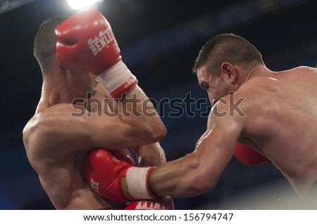 GALATI, ROMANIA - AUGUST 23: Flavius Biea (L) and Ionut Trandafir (R) fight at the WBO welterweight title,  on August 23, 2013, in Galati, Romania. - stock photo