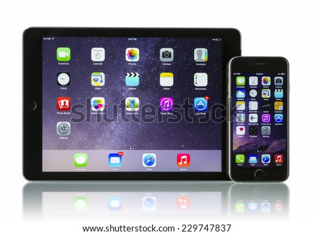 Galati, Romania - November 6, 2014: Apple Space Gray iPhone 6 and iPad Air 2  with iOS 8. Apple released the iPhone 6  on September 9, 2014. Apple released iPad Air 2 on October 16, 2014. - stock photo