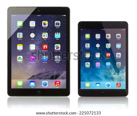 Galati, Romania - October 16, 2014: Apple iPad Air Wi-Fi + Cellular displaying iOS 8 and iPad Mini with iOS 7.1 homescreen. iOS 8 system designed by Apple Inc. official output 16 October 2014. - stock photo