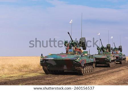 GALATI, ROMANIA - OCTOBER 8: Romanian infantry combat vehicles M84 ''JDER'' in Romanian military polygon in the exercise Smardan Danube Express 14 on Galati, Romania, 8 october 2014. - stock photo