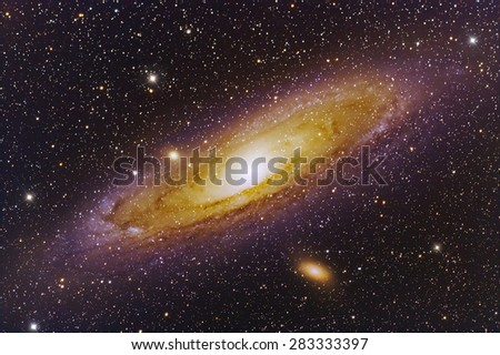 Galaxy Andromeda with Nebula,stars and space dust in the universe long expose. - stock photo
