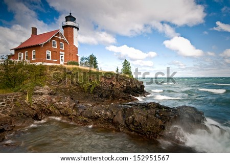 Gale force winds on Lake Superior produce crashing waves at Michigan's Eagle Harbor Lighthouse. - stock photo