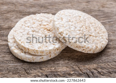 Galette rice with few calories. On wood texture. - stock photo