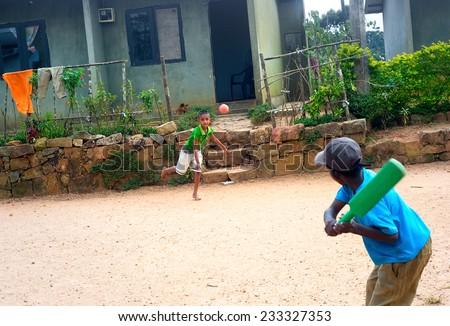GALLE, SRI LANKA -  JAN 27, 2012: Srilankan boys playing cricket. Cricket is most popular game in Sri Lanka - stock photo
