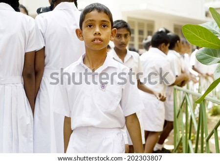 Galle, Sri Lanka - January 26, 2011: Portrait of an unidentified Sri Lankan pupil  during 5 Annual School Festival on January 26, 2011 in Galle, Sri Lanka - stock photo