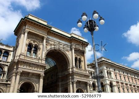 Galleria Vittorio Emanuele II, upper front facade, Milan, Italy - stock photo
