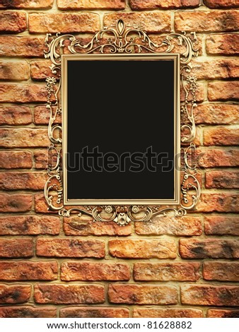 Gallery, empty golden frame on brick wall - stock photo