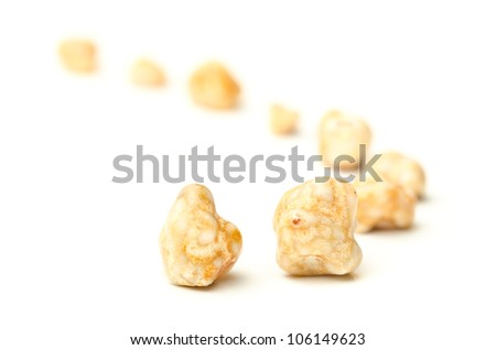 Gallstones removed from a person's gall bladder by surgery on white background - stock photo