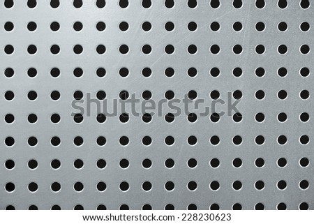 Galvanized perforated steel. Pegboard. - stock photo
