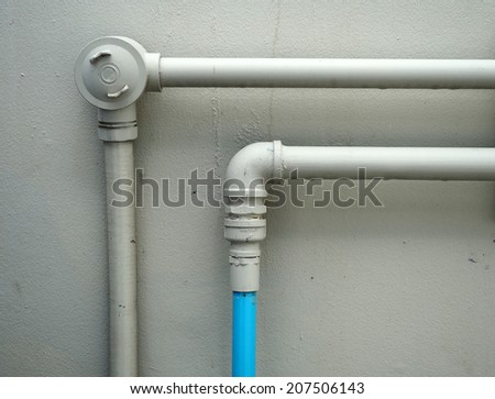 Galvanized steel pipe with tee, elbow, fitting and valve, water piping system - stock photo