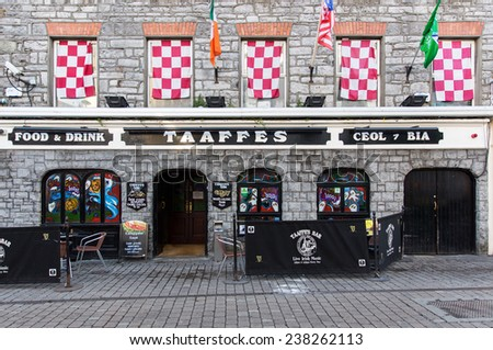 GALWAY, IRELAND  OCTOBER 24, 2014: Taaffes Bar. Located within Galway's Latin Quarter it is known as a meeting point for gaelic football supporters and features traditional Irish music. - stock photo