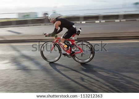 GALWAY, IRELAND - SEPTEMBER 2: Athlete Justin Robbins (892)  compete at the Course Bike during 2nd Edition of the annual Ironman 70.3 Galway 2012 Triathlon,on September 2, 2012 in Galway, Ireland. - stock photo