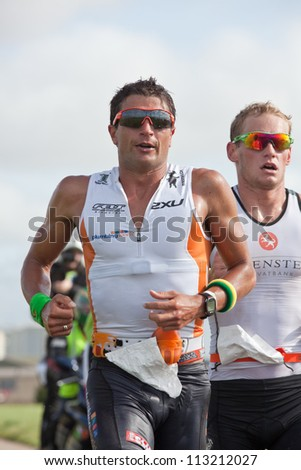 GALWAY, IRELAND - SEPTEMBER 2: T.Bozzone and  Jan Van Berkel, Winner, competing at the Course-Run during 2nd Edition of the Ironman 70.3 Galway 2012 Triathlon,on September 2, 2012 in Galway,Ireland. - stock photo