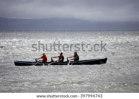 GALWAY - MAY 26: Unidentified athlets compete in All Ireland Currach Racing, during traditional annual An Tostal Festival, on May 26, 2013 in Galway, Ireland. - stock photo