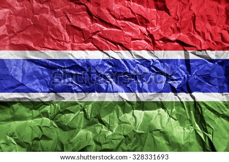 Gambia flag painted on crumpled paper background - stock photo