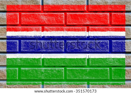 Gambia flag painted on old brick wall texture background - stock photo