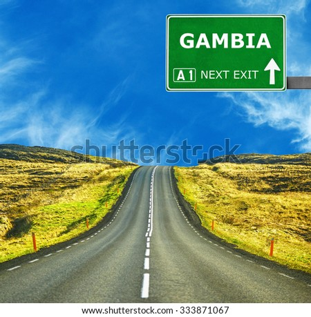 GAMBIA road sign against clear blue sky - stock photo
