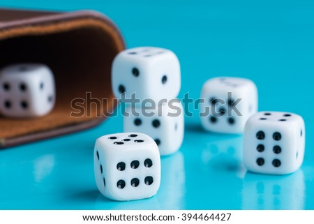 Gamble and taking risk concept - White dices against a blue background - Winners and losers - stock photo
