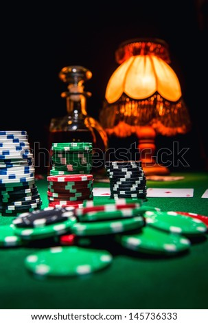 Gamble background, poker chips, cards and bottle of cognac - stock photo