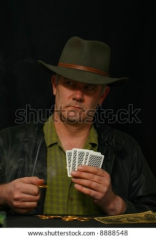 Gambler placing bet and looking to his right - stock photo