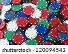 Gambling background with poker chips. Full frame. - stock photo