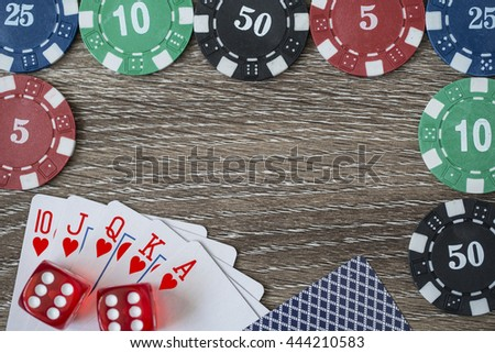 Gambling chips and poker card on wooden background - stock photo