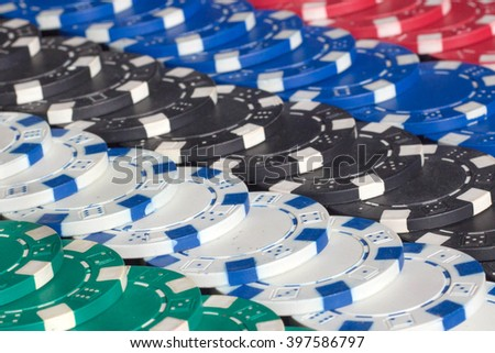 Gambling, fortune, game and entertainment concept - close up of casino chips background. Many poker chips. - stock photo