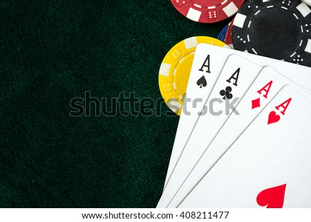 Gambling Poker Cards and Casino Money Chips - stock photo