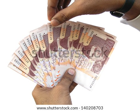 Gambling with Pakistani currency - stock photo