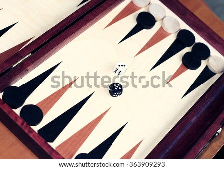 Game board with dice for a game of backgammon. - stock photo