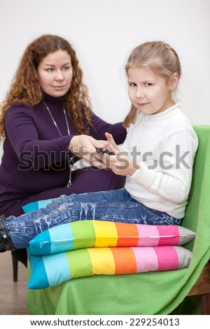 Game dependence in the child, mother takes away smartphone - stock photo