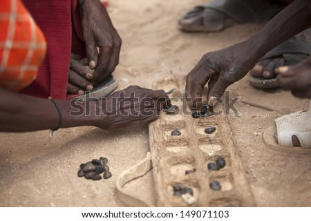 Game of Bao played in East and Central Africa - stock photo