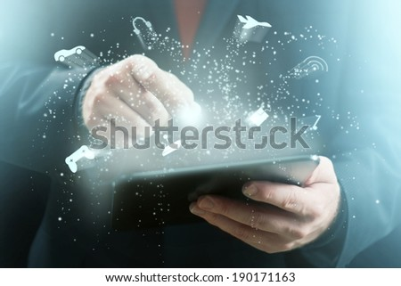 Game Related Icons Sparkling Around Tablet Computer - stock photo