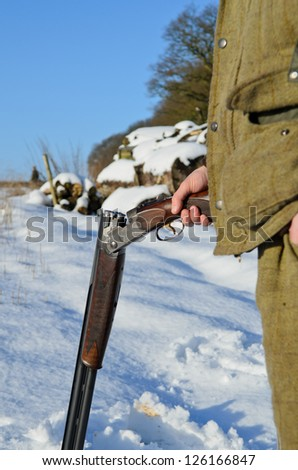Gamekeeper holding a loaded shotgun - stock photo