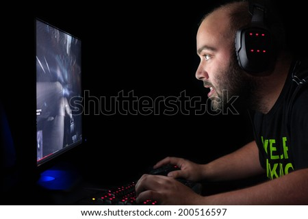 Gamer playing a first person shooter on high end pc. - stock photo