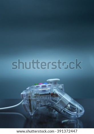 Games controller and sci-fi background - stock photo