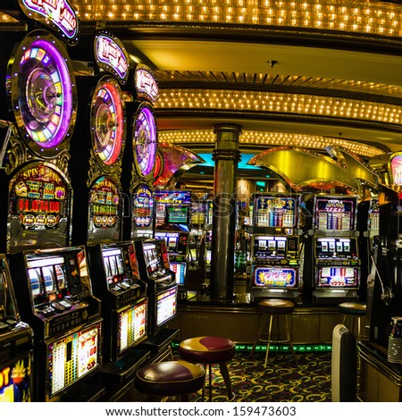 Gaming slot machines in American gambling casino in the cruise liner Vision of the Seas of Royal Caribbean International, USA. - stock photo