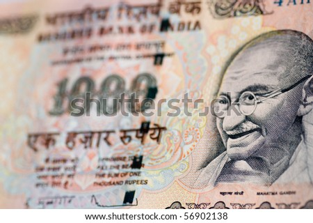 Gandhi banknote from India A one thousand rupee banknote from India with the focus on the face of Mahatma Gandhi. - stock photo