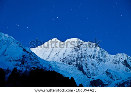Gangapurna and Annapurna mountains on the blue sky with stars, Himalaya, Nepal - stock photo