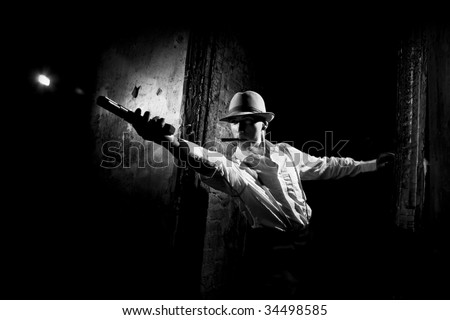 gangster in action - stock photo