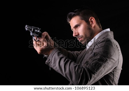Gangster or private security or detective with a gun aiming - stock photo