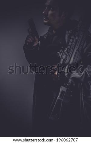 gangster, portrait of murderer with gun - stock photo