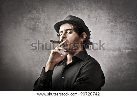 Gangster smoking a cigarette - stock photo