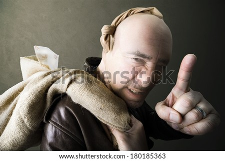 gangster warning for silence after robbery - stock photo