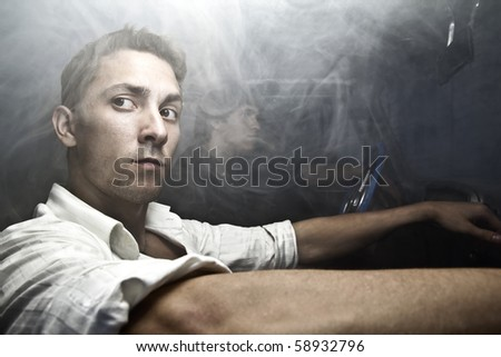 gangsters in the car full of smoke - stock photo