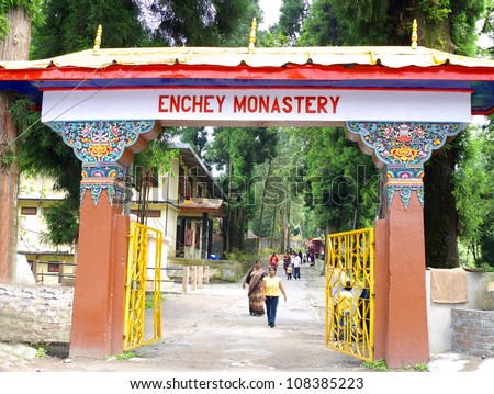GANGTOK, SIKKIM/ INDIA-JUNE 12: Tourists walking in and out of Enchey Monastery at the entrance gate on June 12, 2012 in Gangtok. Enchey Monastery is among Sikkim'Â?Â?s famous monuments. - stock photo