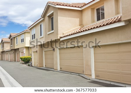 Garages face the alley way for these modern townhomes.  - stock photo
