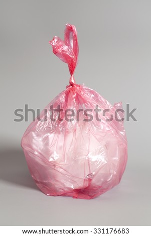 garbage bag on a gray background  - stock photo